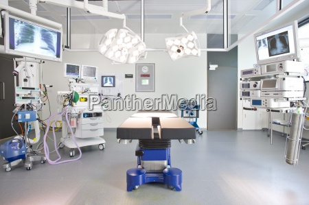 hospital operating room with monitors and