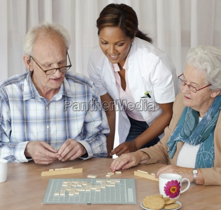 a senior couple and care assistant