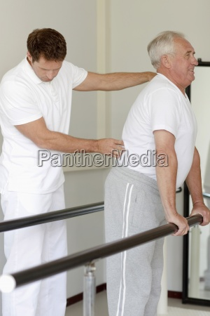 a senior man having physiotherapy