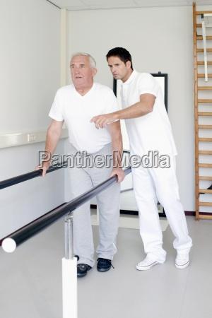 a senior man having physiotherapy