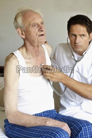a doctor examining a senior mans
