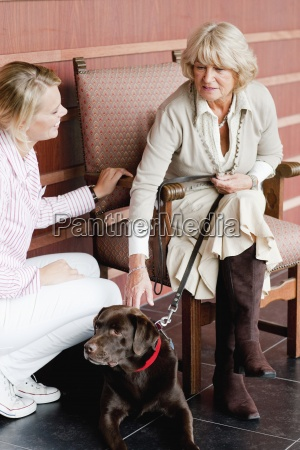 a female care assistant talking to