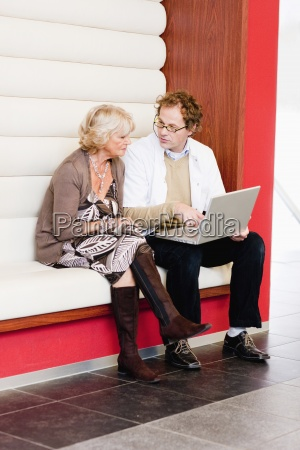 a senior woman with medical consultant