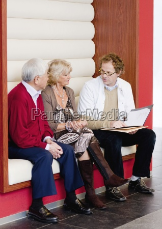 a senior couple talking to a