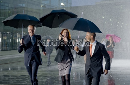 businesspeople walking past a modern office