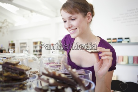 a woman choosing chocolate in a