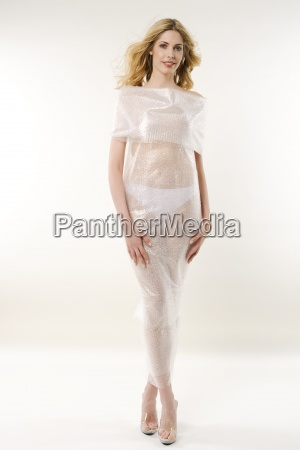 a woman wearing a plastic see