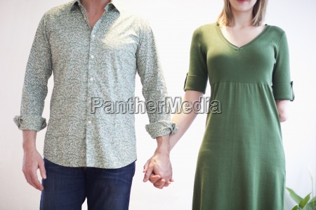 cropped view of couple holding hands