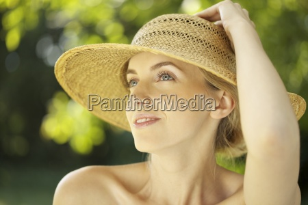 portrait of young woman in straw