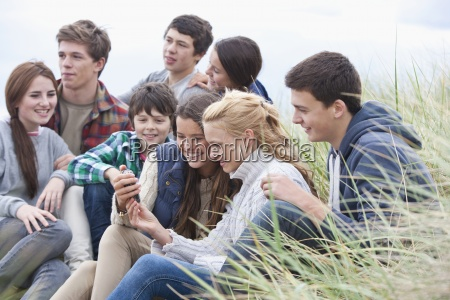 teenage friends reading text message on