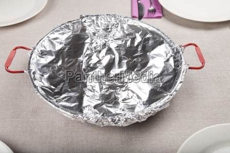 paella resting with foil