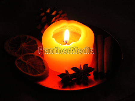 christmas decoration with burning candle