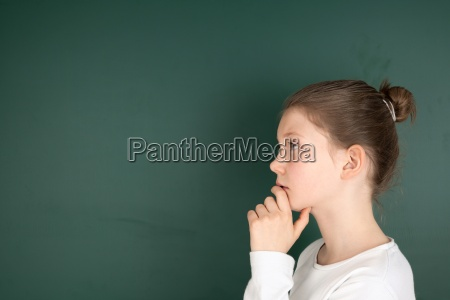 student at blackboard while thinking