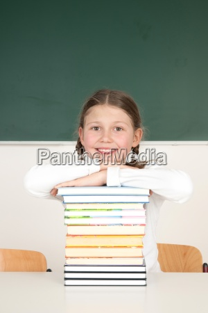 schoolgirl leaning on a pile of