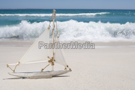 close up of toy sailboat on