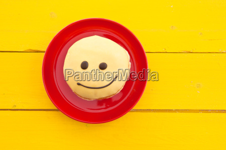 doughnuts with funny smiley face with
