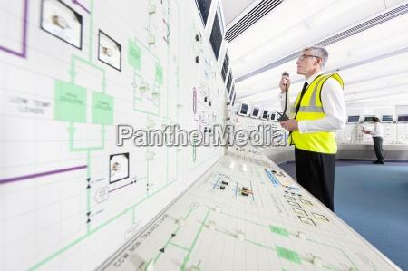 engineer using walkie talkie in control