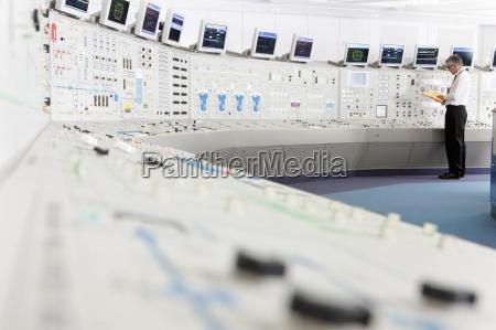 engineer working in control room of