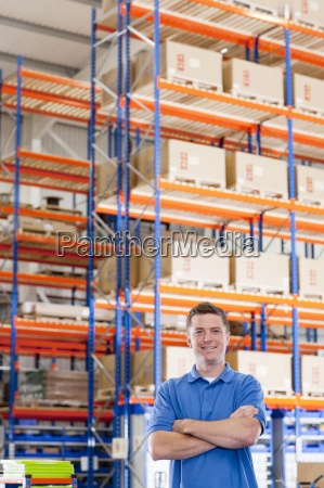 portrait of smiling worker with arms