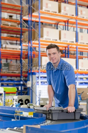 portrait of confident worker with bin