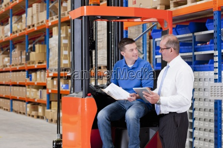 supervisor and worker with paperwork and