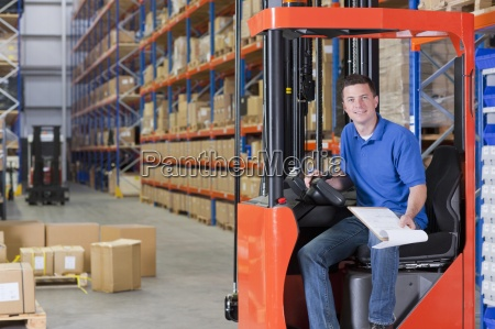 portrait of smiling worker sitting in