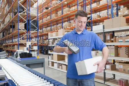 worker scanning box at production line