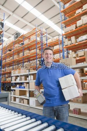 portrait of smiling worker holding scanner