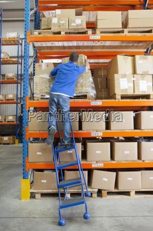 ladder tilting under worker reaching for