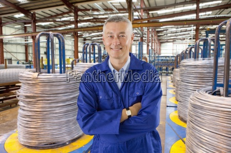 portrait of smiling worker in coveralls