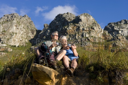 mature couple hiking on mountain trail