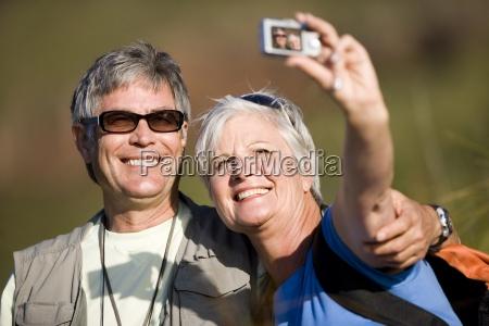 mature couple hiking on mountain trail