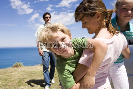 mother embracing son and daughter 7
