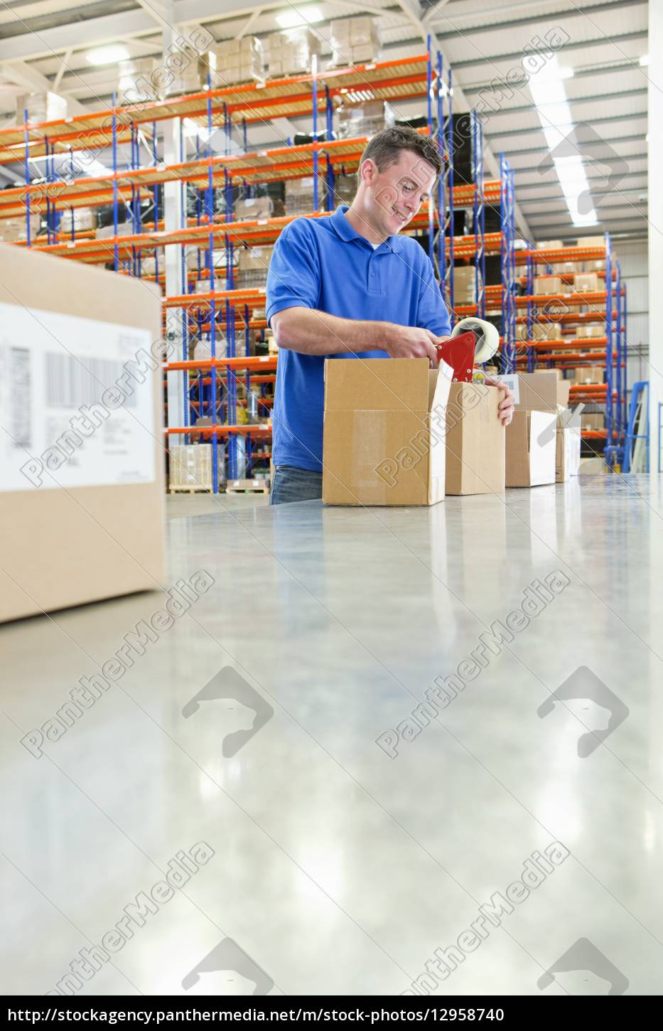 worker, taping, cardboard, boxes, on, production - 12958740