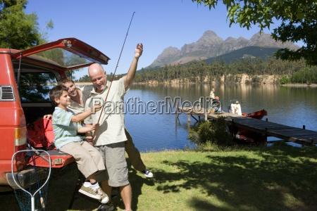 boy 8 10 holding fishing rod