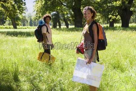 young couple with rucksacks standing in
