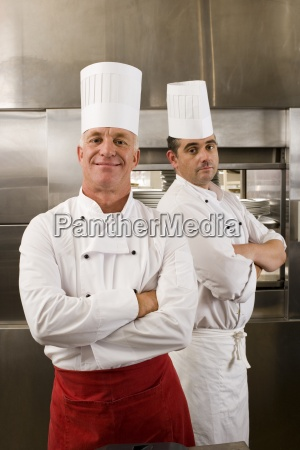 two male chefs standing in commercial