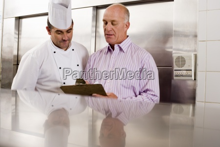 male chef and restaurant manager talking