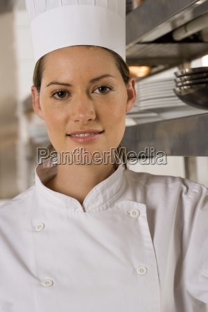 female chef standing in commercial kitchen