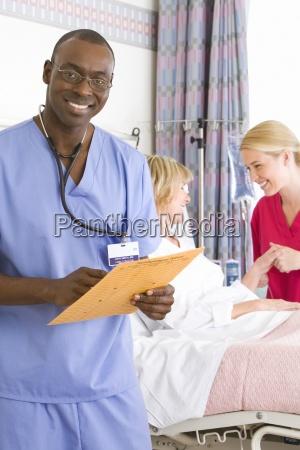 female nurse by mature female patient