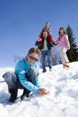 boy 7 9 making snow ball
