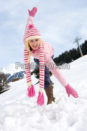 young woman standing in snow field