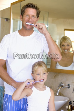 couple and daughter 6 8 brushing