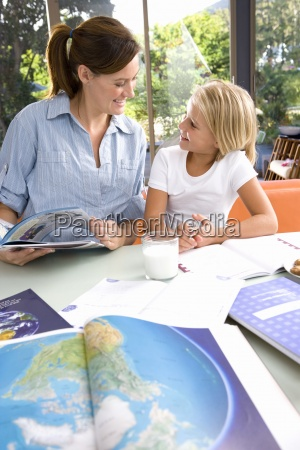 mother helping daughter 6 8 with