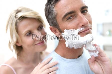 woman embracing man in bathroom man