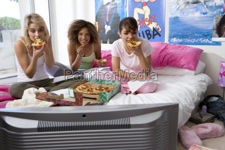 three teenage girls 15 17 sitting