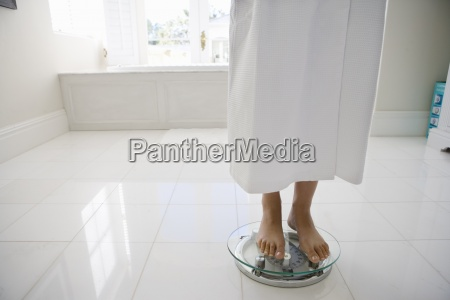 young woman wearing white bath robe