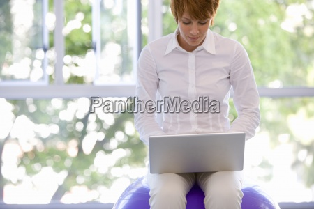 young businesswoman using laptop computer on