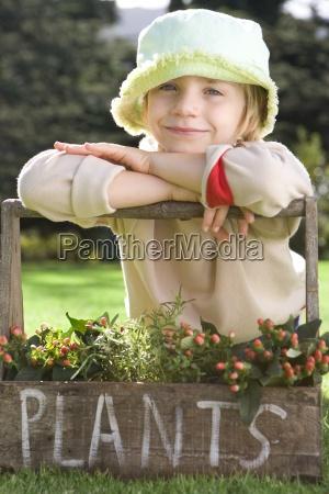 girl 5 7 wearing hat leaning