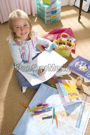 girl 8 10 drawing in bedroom